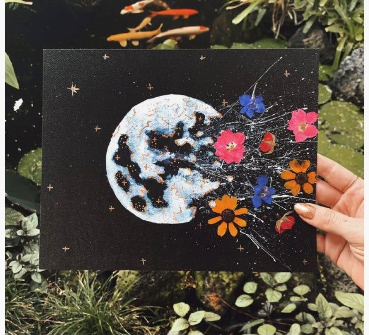 Painting of moon and flowers