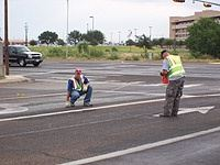 Traffic Division Workers near an Intersection